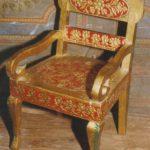 Usta Kaam on a chair