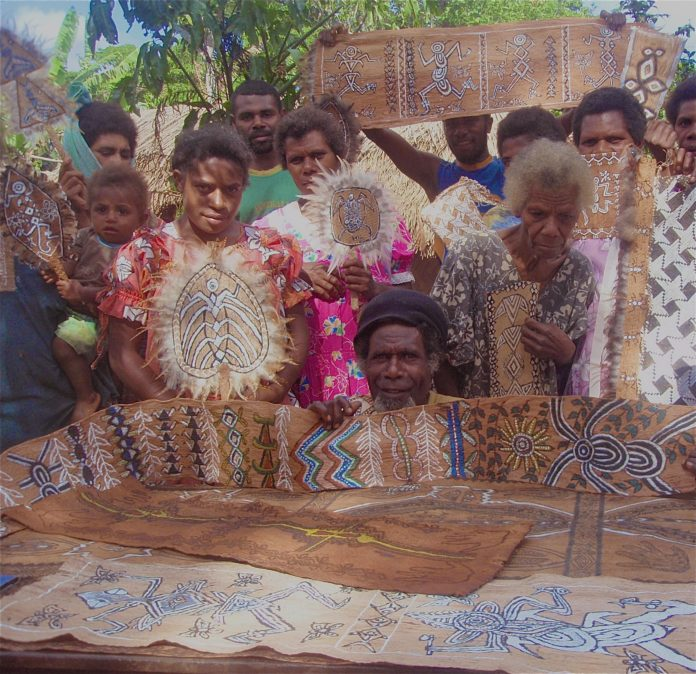 Chief Jerry Taki (centre) with Erromangans proudly displaying some examples of the newly made decorated barkcloth collection for the Australian Museum at the Umponielongi cultural-festival, southern Erromango, May 2008.
