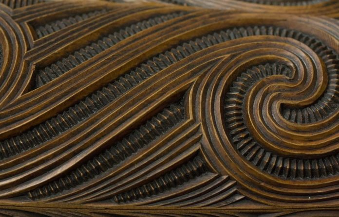 Example of whakairo surface design with haehae/carved parallel ridges and pakati/notching. This is a detail of a waka huia/treasure box carved by Te Rangikapiki Fraser.