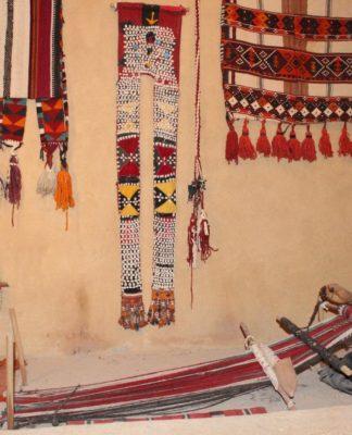 Al-Sadu weaver weaving on a typical floor loom.