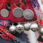 Silver buttons, coins and beads as decoration of the woman's hat kep takya. Osh province. Beginning of XX century